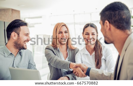 Business team of four plan work in office.Teamwork concept. #667570882