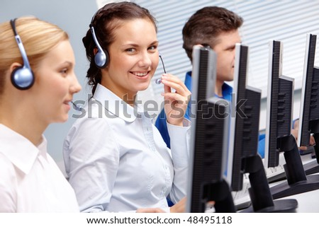 Business team of operators sitting at the table during telephone conversation