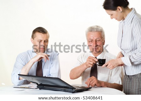 business team of three people on a white