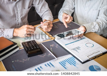 Business team on meeting to planning investment trading project and strategy of deal on a stock exchange with partner, financial and accounting concept, collaborative teamwork analyze data. #1408842845