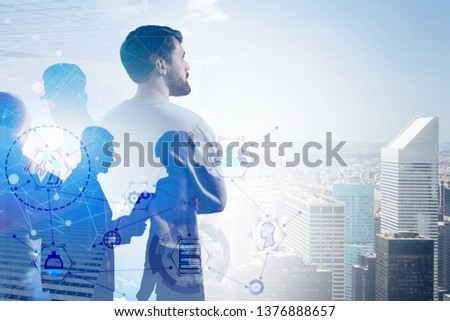 Business team over city background with GUI and network hologram. Concept of technological startup. Toned image double exposure #1376888657