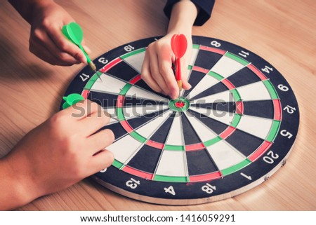 Business team pointing to a darts aiming at the target center business,Targeting the business concept #1416059291