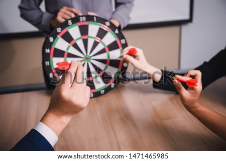 Business team pointing to a darts aiming at the target center business,Targeting the business concept #1471465985