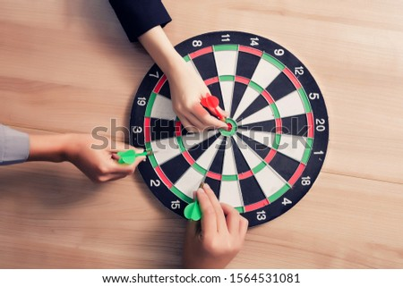 Business team pointing to a darts aiming at the target center business,Targeting the business concept #1564531081
