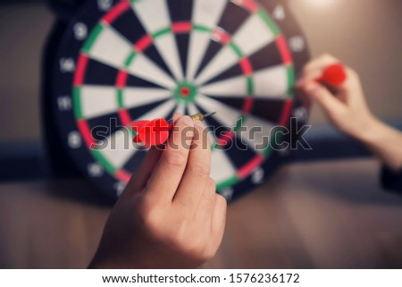Business team pointing to a darts aiming at the target center business,Targeting the business concept #1576236172