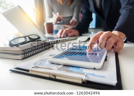 Business team present. professional investor working new start up project. tablet laptop computer with digital marketing media in the office. #1263042496