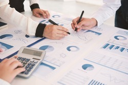 business team presentation data of financial report or marketing figures, graphs and charts for review business strategy plan.