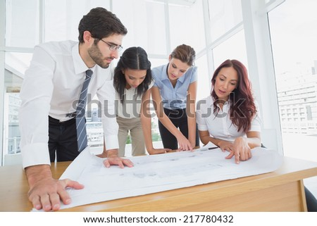 Business team reading work plans in the office