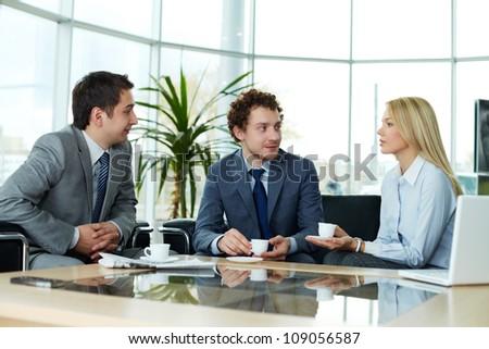 Business team sharing ideas during break
