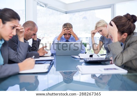Business team smiling at camera in the office - Shutterstock ID 288267365