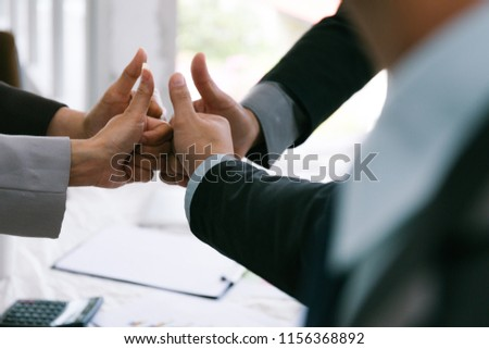 business team stacking hands - Shutterstock ID 1156368892