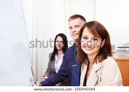 Business team stand beside whiteboard