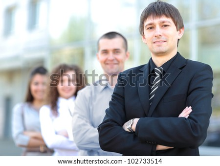 business team standing in a row at office and looking at camera - Successful business team
