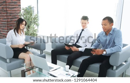business team studying working papers, sitting in the office