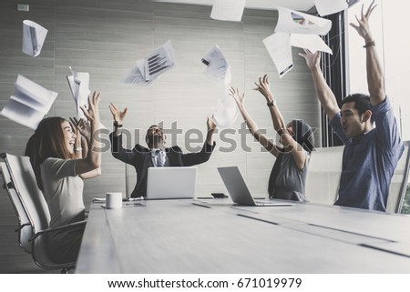 business team throwing paper when meeting success with happy emotion together, people with successful concept, #671019979