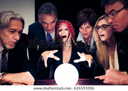Business Team Using A Crystal Ball To Look Into Future #626591006