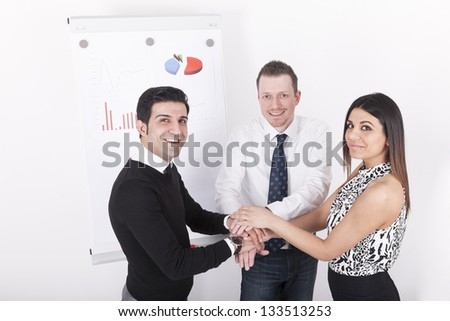 Business team  with hands on top of each other. studio shot on a white background.