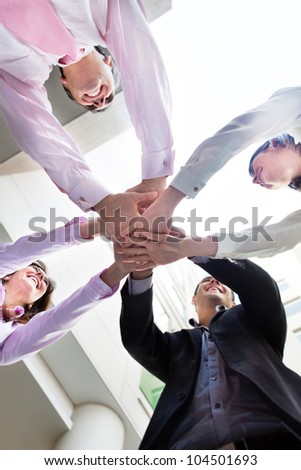 Business team with hands together in the middle