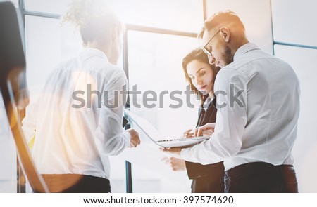 Business team work process. Photo professional crew working with new startup project. Project managers meeting. Analyze business plans laptop. Blurred background, film effect, bokeh. Horizontal