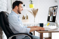 Business team working from home in a video conference. The guy communicates via video call with his business colleagues about the future strategy. Distant work