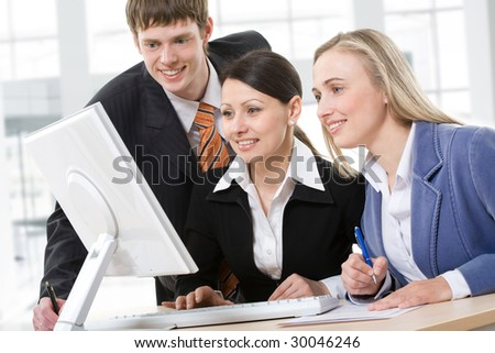 Business Team Working in front of PC monitor