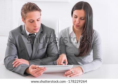 Business team working in office - Shutterstock ID 178229264