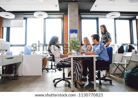 Business team working in the office sitting at the table