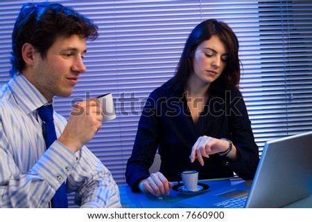 Business team working late in office.