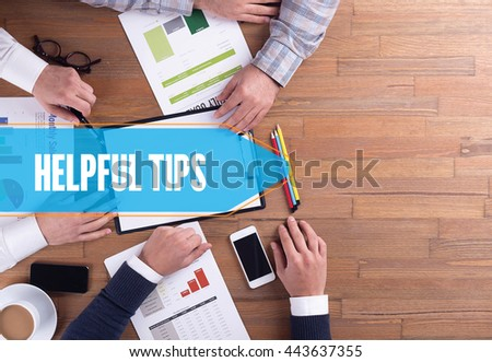 BUSINESS TEAM WORKING OFFICE HELPFUL TIPS DESK CONCEPT