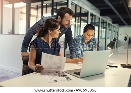 Business team working on computer in open space modern office