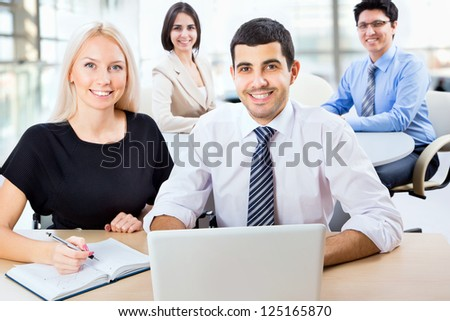 Business team working on their business project together at office