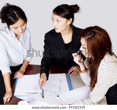 Business team working on their business project together at office - Team work - stock photo