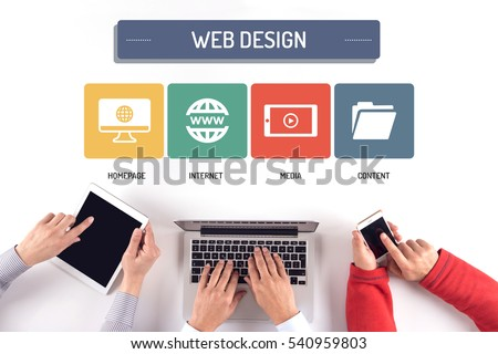 BUSINESS TEAM WORKING ON WEB DESIGN CONCEPT