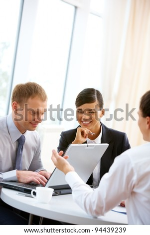 Business team working together with laptop