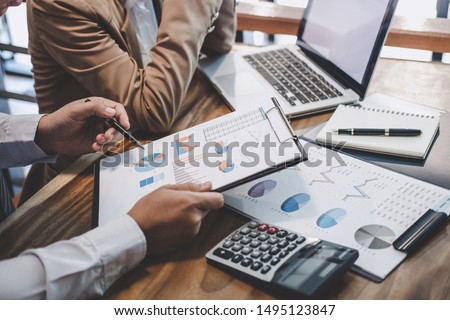 Business team working with new startup project plan and discussion information for financial strategy with laptop and digital tablet in a modern business lounge.