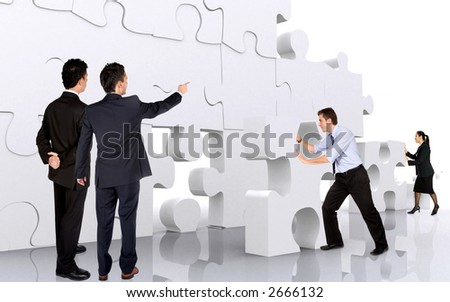 business teamwork business men making a puzzle over a white background