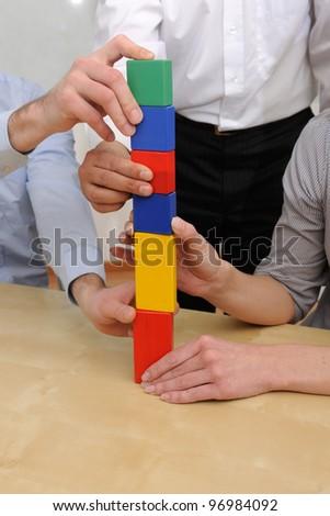 Business teamwork concept: Building tower of blocks