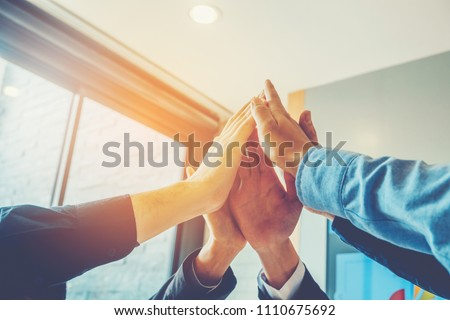 Business Teamwork joining hands team spirit Collaboration Concept #1110675692