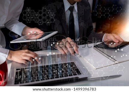 Business teamwork or business partners discussing documents and meeting at the modern office desk. Global Strategy Virtual Icon.Innovation Graphs Interfaces. Workplace strategy concept.