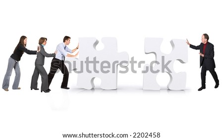 business teamwork - puzzle pieces made in 3d over white