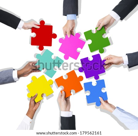 Business Teamwork with Jigsaw Puzzle