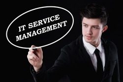 business, technology and internet concept - businessman is writing it service management text
