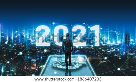 Business technology concept, Professional business man walking on future network Bangkok city background with new year 2021 text and futuristic interface graphic at night in Thailand
