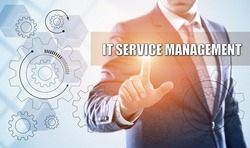 business, technology, information technology, internet and virtual reality concept - businessman pressing it service management button on virtual screens with hexagons and transparent honeycomb