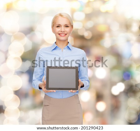 business, technology, internet and advertisement concept - smiling businesswoman with blank black tablet pc computer screen