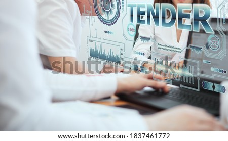 Business, technology, internet and network concept. A group of young people works with a hologram on the screen see the inscription: TENDER Stock photo ©