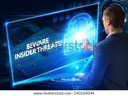 Business, Technology, Internet and network concept. Business man working on the tablet of the future, select on the virtual display: BEWARE INSIDER THREATS! #540164044