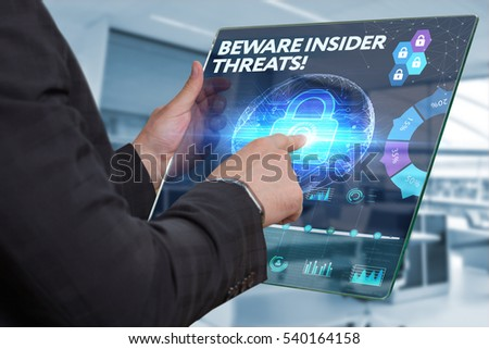 Business, Technology, Internet and network concept. Business man working on the tablet of the future, select on the virtual display: BEWARE INSIDER THREATS! #540164158