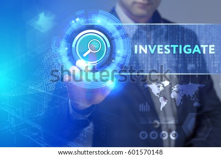 Business, Technology, Internet and network concept. Business man working on the tablet of the future, select on the virtual display: Investigate