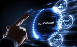 Business, Technology, Internet and network concept. Young business man writing word: Outsourcing